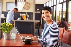 Woman using computer, portrait Stock Photos