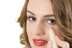 Woman Using Concealer Stock Photo