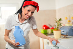 Woman using conditioner for washing machine Royalty Free Stock Photos
