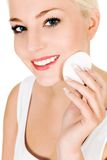 Woman using cotton pad. On face royalty free stock photography