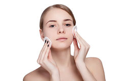 Woman using cotton pad Royalty Free Stock Images