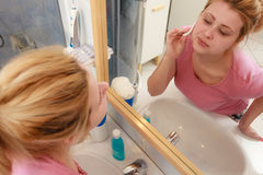 Woman using cotton pad to remove make up Stock Image