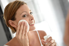 Woman using cotton pads cleansing her face Stock Image