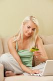 Woman using credit card Royalty Free Stock Image