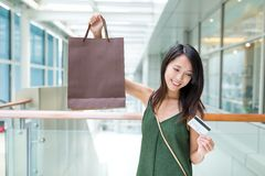 Woman using credit card and holding shopping bag. Asian young woman Royalty Free Stock Image