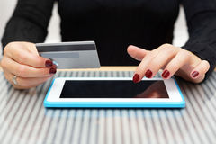 Woman is using credit card for on line shopping Royalty Free Stock Images