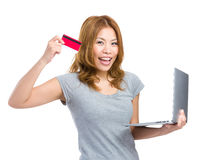 Woman using credit card for onling shopping Stock Photo