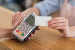 Woman using credit card for payment in cafe Royalty Free Stock Images