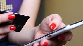 Woman using credit card and phone for online payment. UltraHD video stock footage