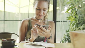Woman using credit card for shopping online with smartphone in cafe. stock footage