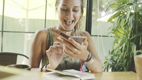 Woman using credit card for shopping online with smartphone in cafe. stock video footage