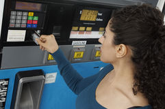 Woman Using Credit Card To Pay For Gasoline Royalty Free Stock Images