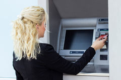 Woman using a credit card Stock Image
