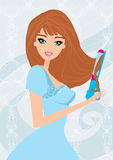 Woman Using Curling Iron to Style Her Hair Royalty Free Stock Photos