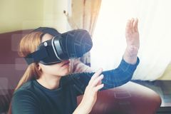 Woman Using 3-D glasses in virtual reality glasses or headset Royalty Free Stock Photo