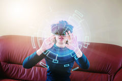 Woman Using 3-D glasses  in virtual reality glasses or headset Royalty Free Stock Photography