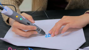 Woman using 3D printing pen stock video footage