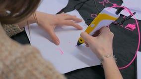 Woman using 3D printing pen stock video