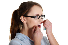 Woman using dental floss. Portrait of a beautiful caucasian woman using dental floss Royalty Free Stock Photography