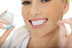 Woman using dental floss. Stock Photography