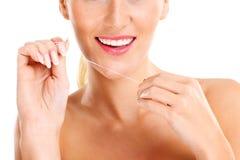 Woman using dental floss Royalty Free Stock Photo