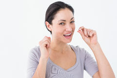 Woman using dental floss Stock Photo