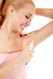 Woman using deodorant Royalty Free Stock Photo