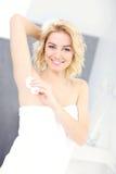 Woman using deodorant Royalty Free Stock Image