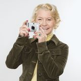Woman using digital camera. Royalty Free Stock Photography