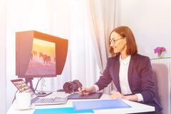 Woman using digital drawing monitor in the office stock images