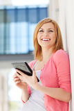 Woman using digital tablet Royalty Free Stock Image