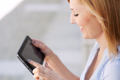 Woman using digital tablet royalty free stock photo