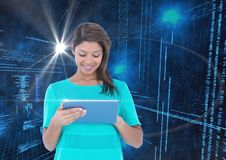 Woman using digital tablet against binary code interface Royalty Free Stock Photos