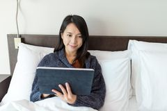 Woman using digital tablet. Asian young woman Royalty Free Stock Image