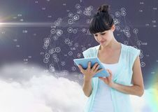 Woman using digital tablet. Beautiful woman using digital tablet against digitally generated icons in  background Royalty Free Stock Photography