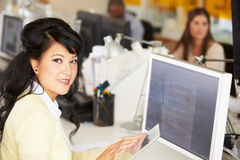Woman Using Digital Tablet In Busy Creative Office Royalty Free Stock Image
