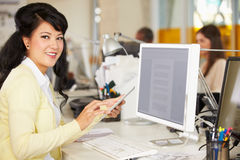 Woman Using Digital Tablet In Busy Creative Office Royalty Free Stock Images