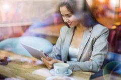 Woman using digital tablet in cafe Royalty Free Stock Photo