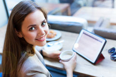 Woman using digital tablet in cafe Stock Photo