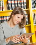 Woman Using Digital Tablet In College Library Stock Photo