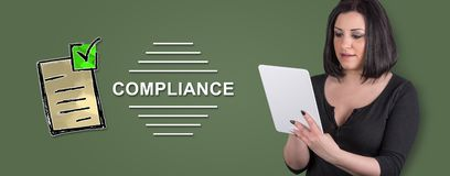 Concept of compliance. Woman using digital tablet with compliance concept on background stock photography