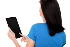 Woman using digital tablet computer Royalty Free Stock Photos