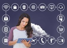 Woman using digital tablet with connecting icons and cloud in background. Digital composition of woman using digital tablet with connecting icons and cloud in Royalty Free Stock Photo