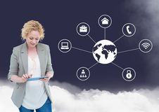 Woman using digital tablet with connecting icons and cloud in background. Digital composition of women using digital tablet with connecting icons and cloud in Stock Photography