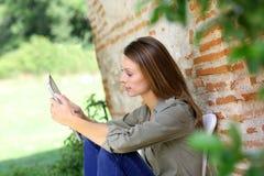 Woman using digital tablet in garden Stock Photos