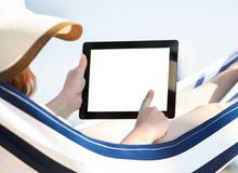 Woman using digital tablet in hammock Royalty Free Stock Images