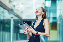 Woman using digital tablet  and listening music Stock Image
