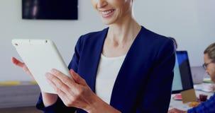 Woman using digital tablet in office 4k. Beautiful woman using digital tablet in office 4k stock video