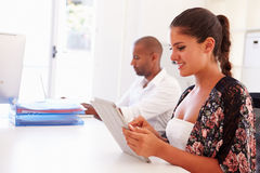 Woman Using Digital Tablet In Office Of Start Up Business Royalty Free Stock Photos