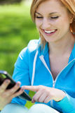 Woman using digital tablet outdoors Stock Photos
